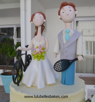 Cyclist and tennis player wedding topper