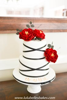 Black and White cake with red sugar peonies