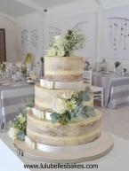 3 Tier semi naked wedding cake with fresh flowers