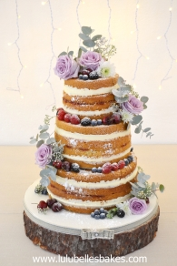 3 tier vanilla naked sponge with fresh berries and flowers
