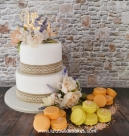 Simple two tier with Orange and yellow macarons