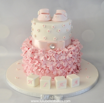 Pink Ruffle christening cake with shoe topper