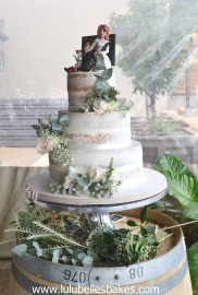 3 Tier semi naked wedding cake with personalised topper