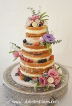 3 Tier naked cake with fresh berries and flowers