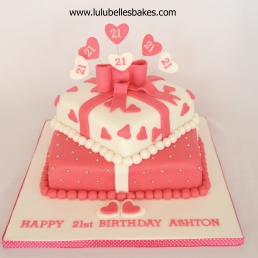 2 tiered square cake with hearts and bow