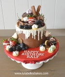 chocolate drip with fresh fruit and chocs