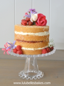 Naked vanilla cake with strawberry coulis filling