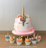 Rainbow sponge unicorn cake with matching cupcakes