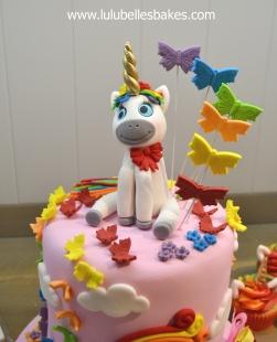 Rainbow unicorn and butterflies