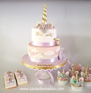 2 Tier Pastel unicorn cake, cupcakes and biscuits