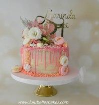 Semi naked vanilla sponge drip cake